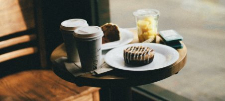 2 coffees with muffin on wood table | hard bean